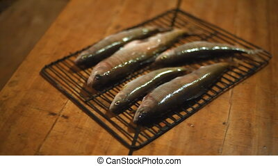 Fish on the grill on the table. - Grayling fish is on the...