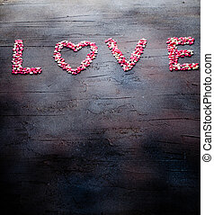 Word Love made with small candy hearts, pink, red, whie...