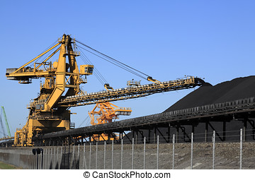 Coal Conveyor Belt - a huge coal loading conveyor belt piles...