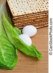 Matzot, eggs and lettuce - symbols of jewish passover