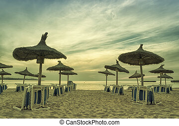 Panoramic image of sunrise on the beach in Mallorca. Europe....
