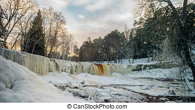 Keila-Joa waterfall panorama by winter sunset, Estonia -...