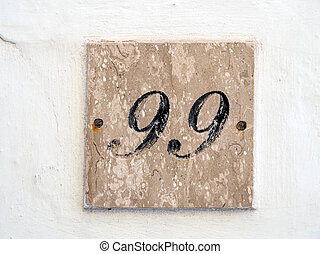 number on a house wall