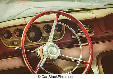 Weathered dusty interior of a classic car