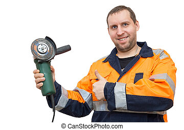man in overalls with a grinder