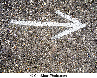 arrow on road - on a road with an arrow painted