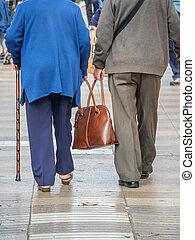 oap couple mitt bag - an elderly couple carrying a bag...