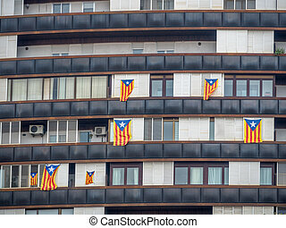 catalan flags on a house - house in barcelona. windows...