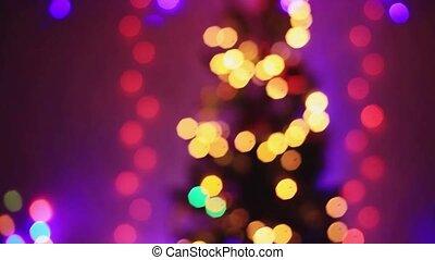 Defocused Christmas tree with Colorful bokeh and christmas lights. 1920x1080