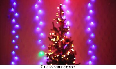 Christmas tree with Colorful bokeh and christmas lights....