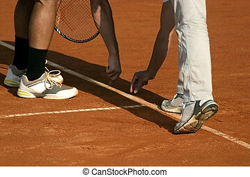 Tennis line referee and tennis player after serve