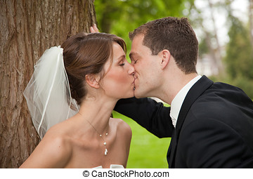 Bride and groom kissing - Beautiful bride and groom kissing...