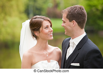 Bride and groom - Beautiful bride and groom looking...