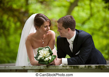Happy bride and groom - Beautiful bride and groom looking...