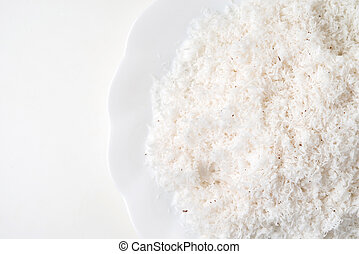 grated coconut in dish