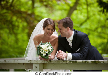 Quiet happiness - Beautiful bride and groom leaning over the...