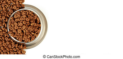 Cat bowl with pet feed on the half white background and scattered dry food