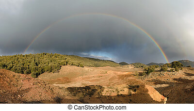 Rainbow and dark clouds, Ifrane National Park, Morocco -...