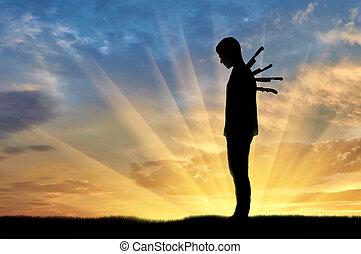 Betrayal and treachery concept. Silhouette of a sad man with...