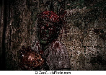 gnaw bones - Bloodthirsty zombie chewing the skull of his...