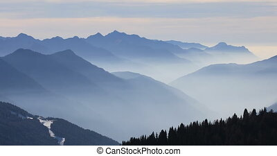 Foggy mountains in winter, Dolomite Alps in Madonna di...