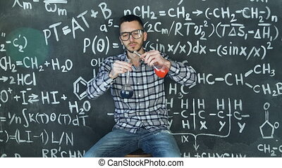 Young scientist man make laboratory experiment in chemical and mathematical equations wall room