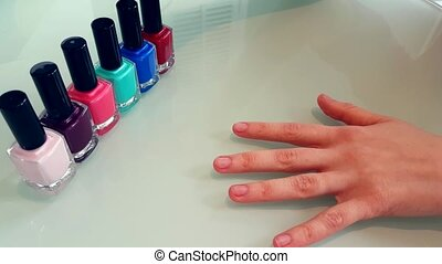 Woman Applying Red Nail Polish - Young Woman Coloring Her...