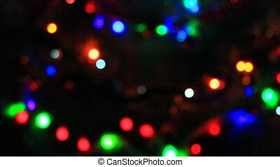 beautiful multicolored lights twinkle in the night -...