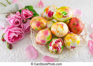 Easter eggs and pink roses bouquet - Easter eggs in a bowl...