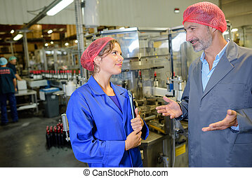 Male and female workers talking