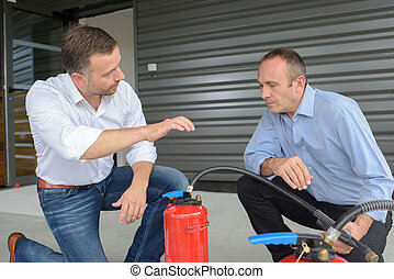Men with fire extinguishers