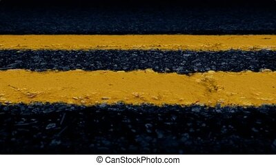 Moving Past Road Lines Closeup - Slowly moving along yellow...
