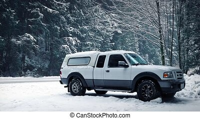 Truck Parked In Snowy Forest With Passing Vehicles - Truck...