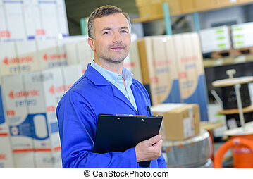 logistic worker holding a form