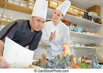 team of bakers in a commercial kitchen