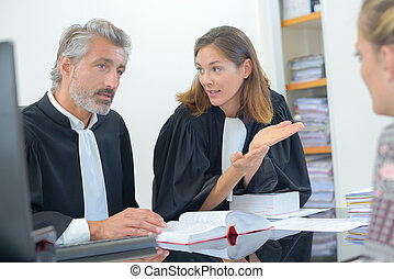 Lawyers talking with client