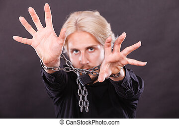 Scared man with chained hands, no freedom - No freedom,...