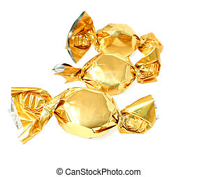 three golden candy isolated