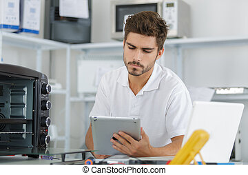 attractive repairman concentrated at work