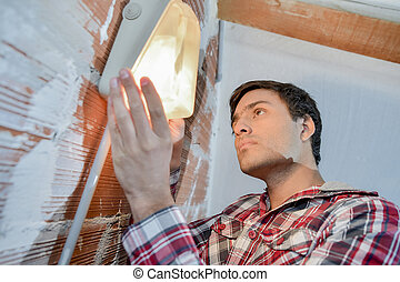 DIY enthusiast installing a light
