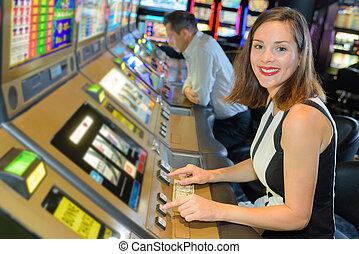 Smiling woman playing arcade game