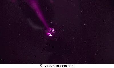 Pour the liquid universe. Oil pour well. Purple oily liquid...