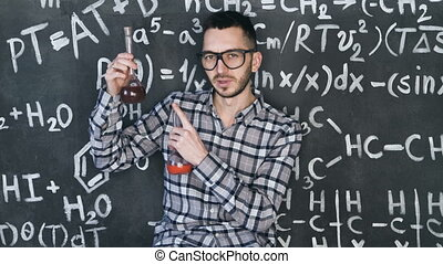 Young scientist man make laboratory experiment in chemical...