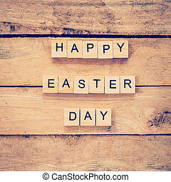 Wooden text of Happy Easter Day on wood background