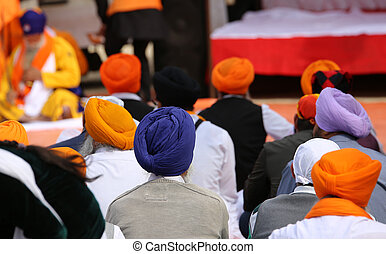 men with large turbans during religious festival - many men...