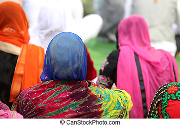 woman with a headscarf to cover her head during a gathering...