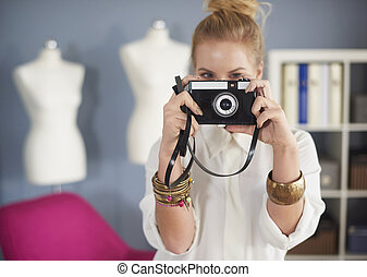 Close up of woman taking a photo