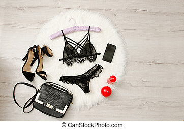 Fashionable concept, a set of lacy underwear, shoes,...