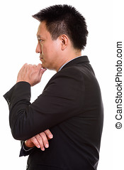 Profile view of Japanese businessman thinking