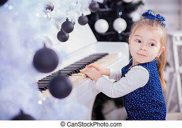 beautiful little girl piano and looking at camera -...